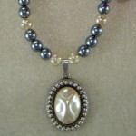 Pearl Glass Beaded Necklace With A Pearl Cabochon