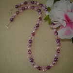 Pink Beaded Necklace Accented With A Mixture Of Colors