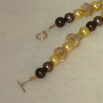 Gold And Brown Beaded Necklace With Mixture Of Shapes And Sizes