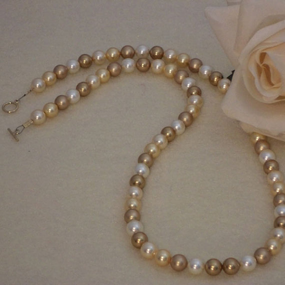 Swarovski Crystal Pearl Necklace In A Mixture of Gold Colors