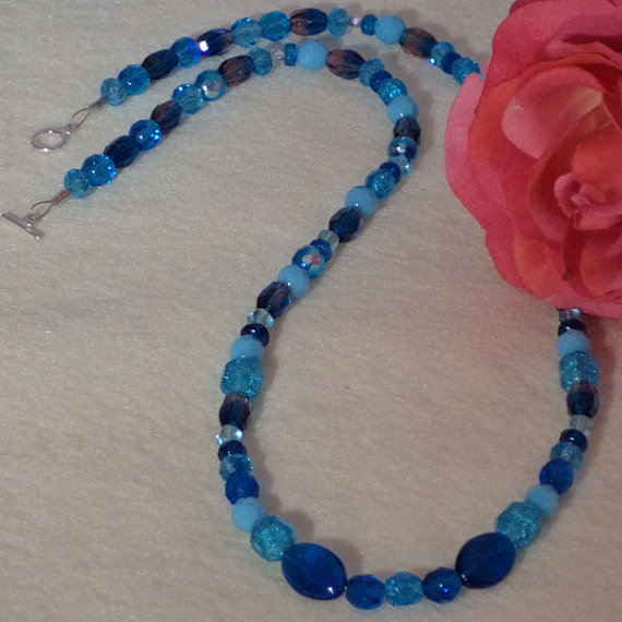 Mixture Of Blue Colors, Shapes And Sizes In Beaded Necklace