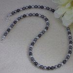 Swarovski Crystal Pearl Necklace In A Mixture Of Grays And Silver